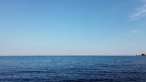 Seascape with blue sea and ships on the horizon. Vladivostok, Russia Live Action