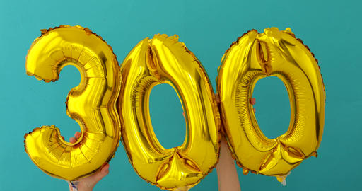 Gold foil number 300 three hundred celebration balloon Footage