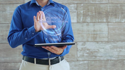 Man uses hologram with text Planet communication Footage