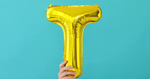 Gold foil letter T celebration balloon Footage