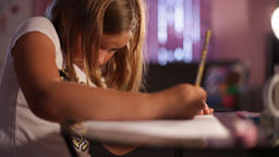 little girl blonde draws a pencil Live Action