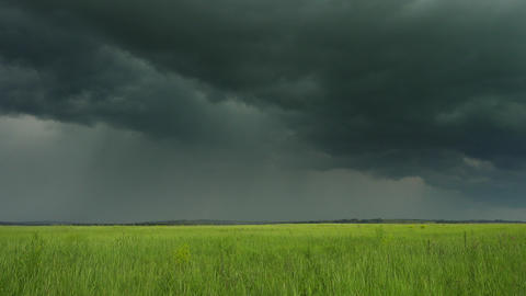 dark storm clouds over countryside field Footage