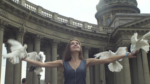 Girl Releasing A Pigeons From Her Arms Footage