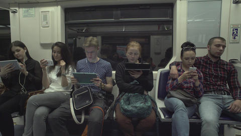 People Are Using Tablets While Riding A Metro Footage