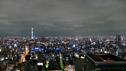 Wide shot of Tokyo Skytree and surrounding city lights from a high observatory Footage