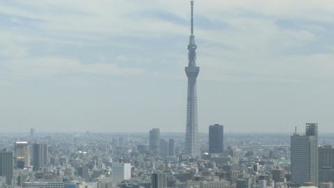 Zoom out shot from the Tokyo Skytree overlooking the densely populated suburbs o Footage