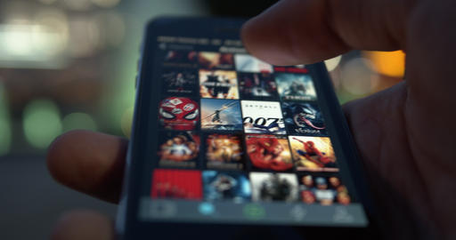 User browsing film database website on a smartphone device Live Action