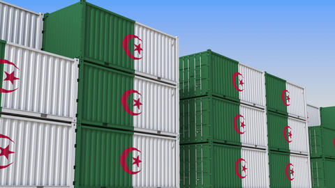 Container yard full of containers with flag of Algeria. Algerian export or Live Action