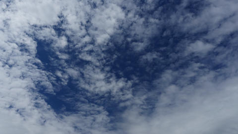 Fluffy white clouds blue sky time lapse motion background Footage