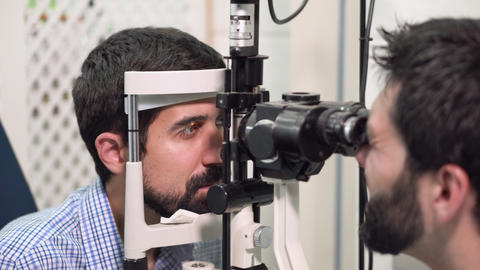 Ophthalmologist Checks young man eyesight - Patient In Ophthalmology Clinic Live Action