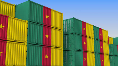 Container yard full of containers with flag of Cameroon. Cameroonian export or Live Action