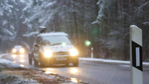 Car moving on winter road on snowy forest background. Winter landscape concept Live Action