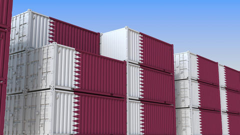 Container yard full of containers with flag of Qatar. Qatari export or import Live Action