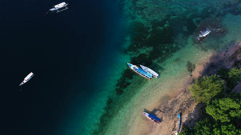 Aerial drone view of boats anchored in the bay with clear and turquoise water Footage