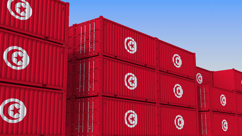 Container terminal full of containers with flag of Tunisia. Tunisian export or Live Action