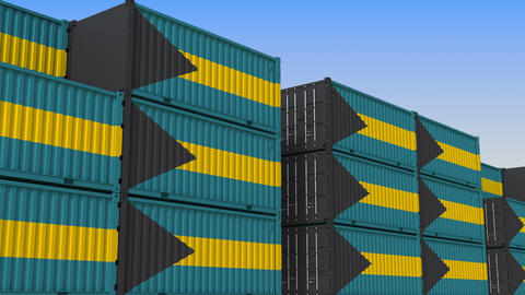 Container yard full of containers with flag of Bahamas. Bahamian export or Live Action