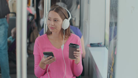 Young woman passenger enjoying trip at the public transport, sitting with Footage