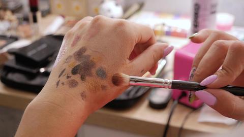 Makeup artist hands mix shadows Live Action