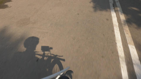 Movement on a mountain bike on the track in the park. View from the face of the Footage