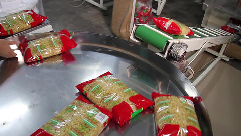 Spaghetti bag on conveyor belt in a pasta factory Footage
