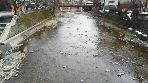Snow falling in rural town with canal in winter season at Takayama city Live Action