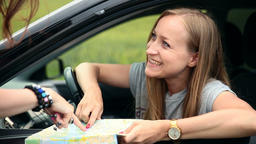 Young tourist woman with car asking for direction Footage