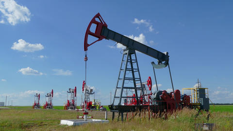 working oil pumps in a row at sunny day Stock Video Footage