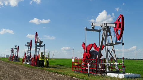 working oil pumps in a row at sunny day Footage