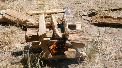 The fire burns. Close-up. Hiking, travel, green tourism concept. Healthy active Live Action