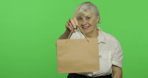 An elderly woman with shopping bag. Shopping. Presents.… Stock Video Footage