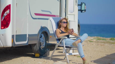 Travel in motorhome. Traveling woman by mobile motor home RV campervan. Woman Footage