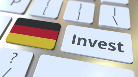 INVEST text and flag of Gemany on the buttons on the computer keyboard. Business Live Action