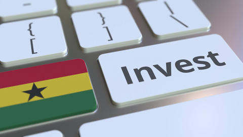 INVEST text and flag of Ghana on the buttons on the computer keyboard. Business Live Action