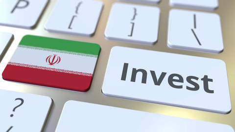 INVEST text and flag of Iran on the buttons on the computer keyboard. Business Live Action