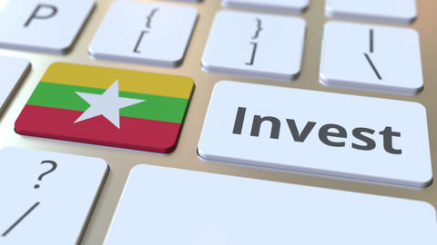 INVEST text and flag of Myanmar on the buttons on the computer keyboard Live Action