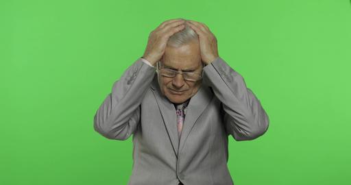 Elderly businessman in suit suffer by headache pain trouble. Old senior man Footage