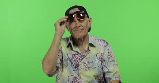 Senior man tourist in sunglasses ready for vacation. Handsome old man Footage