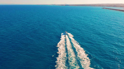 Aerial view. Boat moves on the sea. One boat in the blue sea. Concept travel and Footage