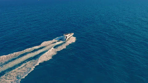 Aerial view. A Powerboat Travelling Through the Water at High Speed Live Action