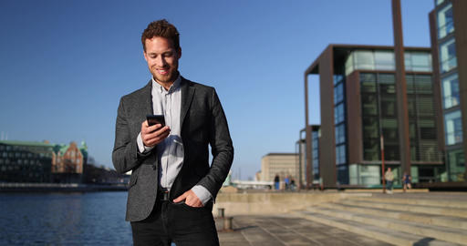 Successful Business Man Talking on Smartphone Walking on City Business Street Live Action