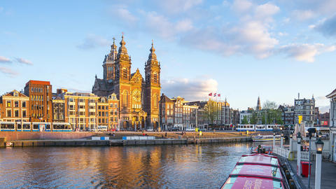 Amsterdam City and canal with landmark buildings in Amsterdam, Netherlands Live Action