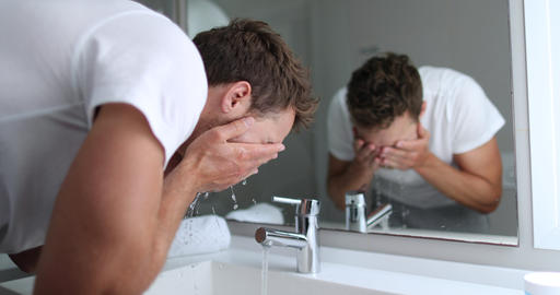 Man washing face rinsing soap from skin in sink under…, Live Action