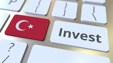 INVEST text and flag of Turkey on the buttons on the computer keyboard. Business Live Action