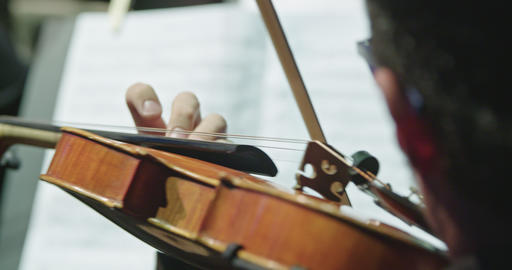 Musician playing Violin during a classical music rehearsal before a concert Live Action