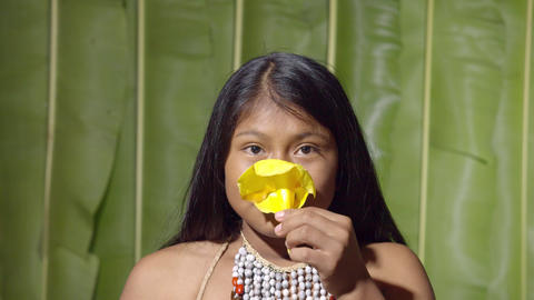 Studio Shot Of A Young Girl Smelling A Flower In Ecuador Live Action