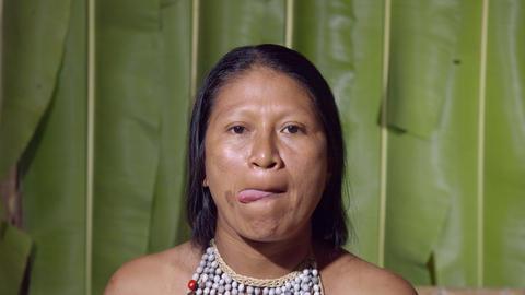 Woman Licking Lips In Ecuador Live Action
