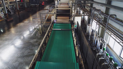 green material transported by conveyor in shop upper view Live Action