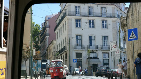 Driving through the streets of Lisbon by tuktuk, pov Footage