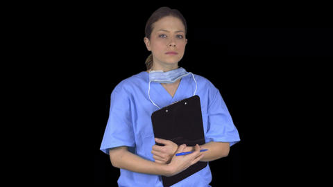 Determined medical professional turns to the viewer (Transparent Background) Live Action
