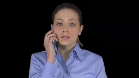 Professional female has a phone conversation (Transparent Background) ビデオ